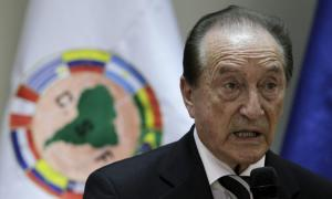 Acting President of the South American Soccer Federation (CONMEBOL) Eugenio Figueredo gives his first news conference since taking charge in Asuncion, Paraguay, in this April 30, 2013 file photo. The Swiss Federal Office of Justice (FOJ) said it had blocked accounts at several banks in Switzerland after police arrested some of the most powerful figures in global soccer on May 27, 2015 in U.S. and Swiss corruption cases. The FOJ said a further wanted soccer official had been arrested on a request from the United States and named Eugenio Figueredo, Eduardo Li, Jose Maria Marin, Julio Rocha, Costas Takkas, Jeffrey Webb, and Rafael Esquivel as the seven officials currently in detention pending extradition.   REUTERS/Jorge Adorno/Files