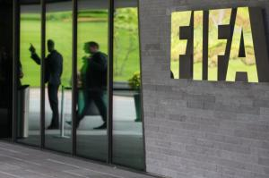 ZURICH, SWITZERLAND - MAY 27: A FIFA logo sits next to the entrance to the FIFA headquarters on May 27, 2015 in Zurich, Switzerland. Swiss police on Wednesday raided a Zurich hotel to detain top FIFA football officials as part of a US investigation into corruption. (Photo by Philipp Schmidli/Getty Images)