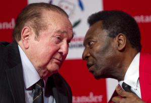 FILE - In this July 4, 2012,  file photo, Paraguay's Nicolas Leoz, President of the South American Football Confederation, CONMEBOL, and former FIFA executive member, left, speaks with former Brazilian soccer  player Pele during a news conference in Sao Paulo, Brazil. Interpol added six men with ties to FIFA to its most wanted list on Wednesday, June 3, 2015, issuing an international alert for two former FIFA officials and four executives on charges including racketeering and corruption. Two of the men, former FIFA vice president Jack Warner of Trinidad and former executive committee member Nicolas Leoz of Paraguay, have been arrested in their home counties. Warner has since been released and Leoz is under house arrest.   (AP Photo/Andre Penner, File)