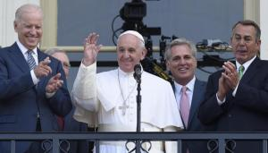 Pope Francis, accompanied by, from left, Vice President Joe Biden, Senate Majority Leader Mitch McConnell of Ky., House Majority Leader Kevin McCarthy of Calif., and House Speaker John Boehner of Ohio, speaks to the crowd from the Speaker's Balcony on Capitol Hill, Thursday, Sept. 24, 2015, after his address to a joint meeting of Congress making him the first pontiff in history to do so. (AP Photo/Susan Walsh)